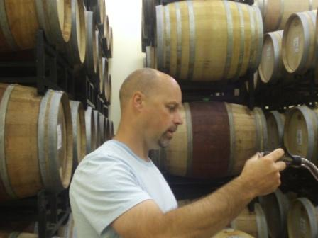 Le Vieux Pin winemaker James Cambridge draws barrel samples