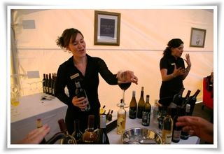 Leah and Melissa from Sister Spirits Beverage Services pour wine for guests.