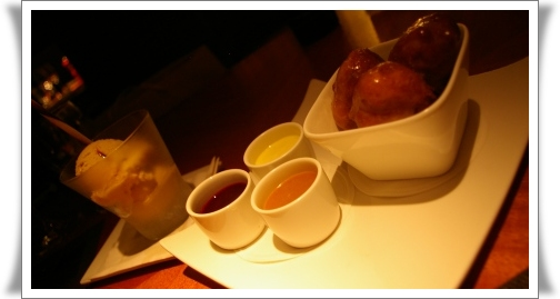 Dessert of house-made apple fritters and bourbon icecream.