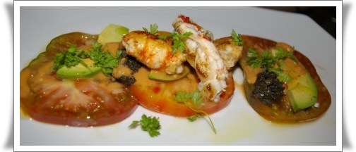 Marinated lobster and spot prawns, served with heirloom tomato and avocado drizzled with a truffle vinaigrette