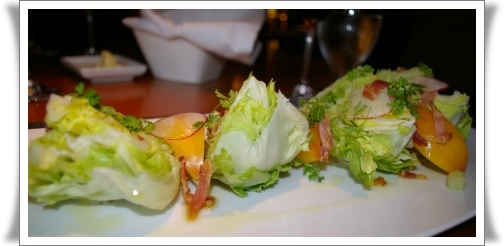 Salad of iceberg wedges, heirloom tomato, boar bacon, and cucumber, with a creamy ranch dressing