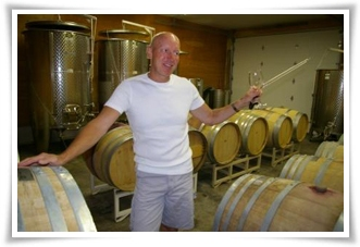 Vern pulls barrel samples of his wines.