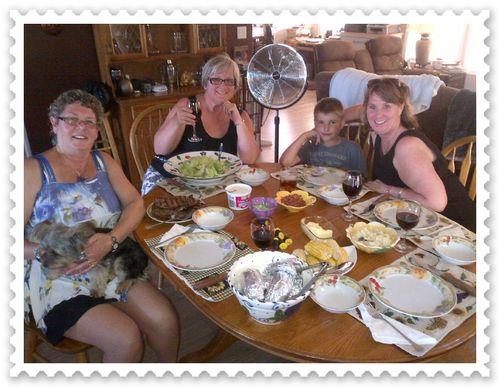 Impromptu dinner for five at Lorrie's-T-bone steak, baked potatoes, corn, Caesar salad, and Nanaimo bars